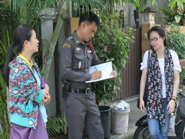 Police question the victim outside the house, south of Phuket City
