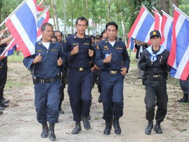 Royal Forest rangers parade through at-threat parkland on Phuket