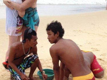 Rescuers work on the British man at Phuket's Karon beach yesterday