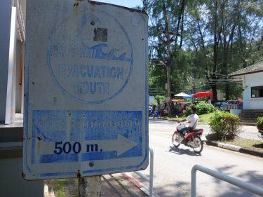 A faded tsunami sign, one of scores disappearing fast on Phuket