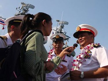 Reporter Chutima  interviews a Burmese Navy captain in February on Phuket during a historic visit by the Burmese Navy to the Royal Thai Navy