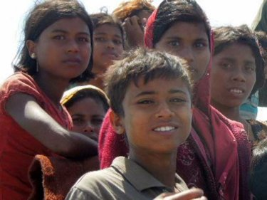 Young women and children, spotted on a Rohingya boat on January 1, 2013