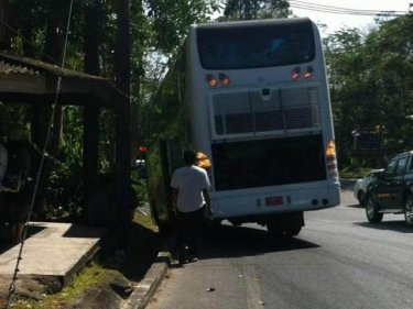 The bus hits a ditch that's a hitch to plans to resume a tour today