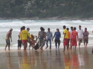 A young man is pulled from the water at Karon beach last year