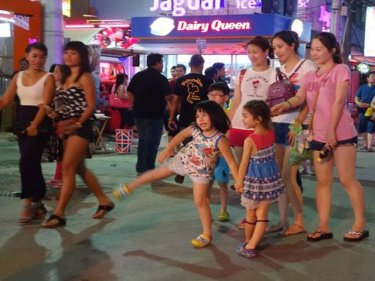Children in Patong play in the Soi Bangla walking street last night