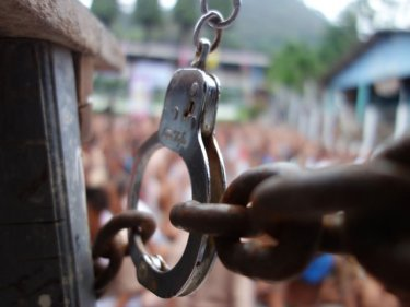 Thousands of prisoners cram into the Phuket jail's central  quadrangle