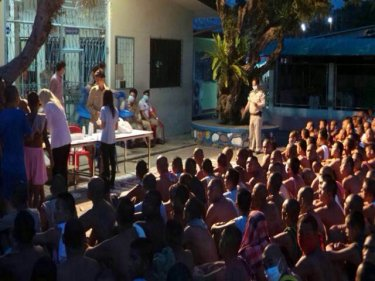 The packed quadrangle of Phuket Prison before dawn today