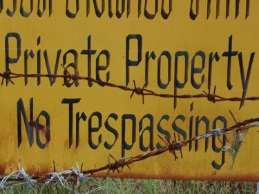 A ''Private Property'' sign on land near Phuket's Sirinath National Park