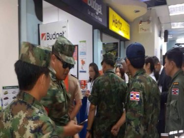 Navy officers begin a month-long task force op at Phuket airport