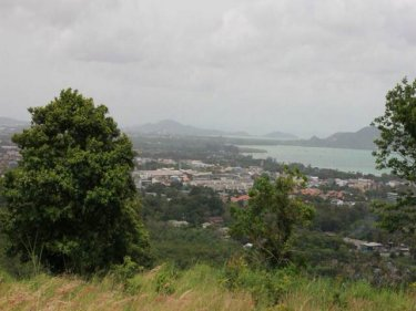 The view from the illegal road and traverse carved on a Phuket hill