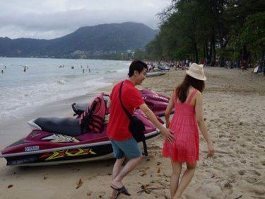First you see them: Patong's jet-skis have moved under the trees