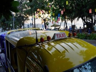 All over Phuket, the old ways of the taxi ''mafia'' are disappearing