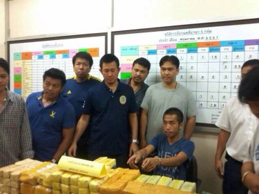 Police with Somboon Seawang and the large Ranong drugs haul