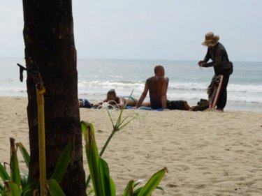 Kamala beach yesterday, and a vendor makes a sale: just what has changed?