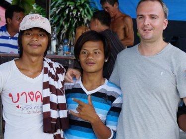 Andy Hall with migrant workers on Phuket earlier this year