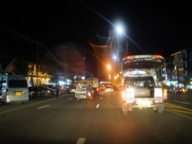 The main street of Khao Lak at night: difficult to cross safely