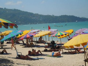 The brollies are back but without sunbeds at Phuket's Patong beach today