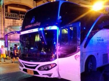 The bus comes to rest after crashing down Phuket's Patong Hill tonight