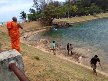A monk prays for the spirit of a boy, sixth child to drown at a Phuket pond