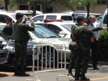 Soldiers at the scene of the arrest of the Israelis in Bangkok yesterday