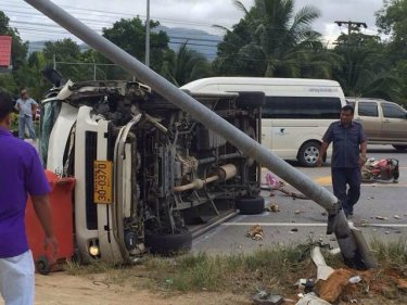 A minivan carrying German tourists flipped onto its side north of Phuket