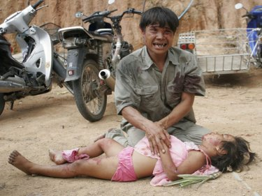 A father mourns his daughter, one of six killed in a Phuket crash in 2011