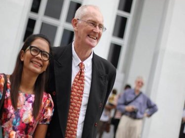 Alan Morison and Chutima Sidasathian outside Phuket Provincial Court