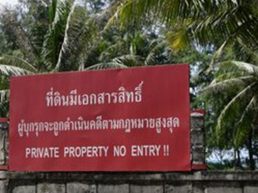 Signs like this cover the last few green spaces on Phuket's west coast