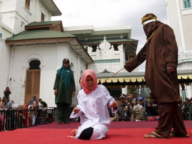 Student Nur Elita is caned for having affectionate contact in Aceh