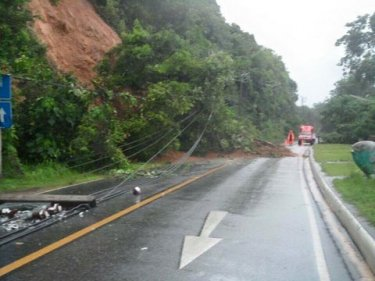 Part of the coast road is blocked by a landslip on Phuket early today