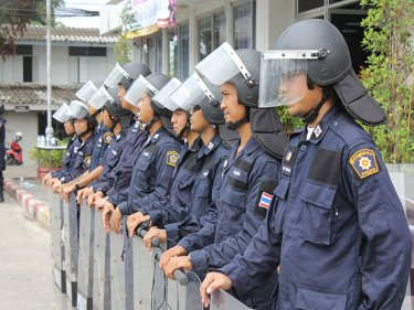 Riot squad outside Thalang Police Station soon after the Phuket uproar